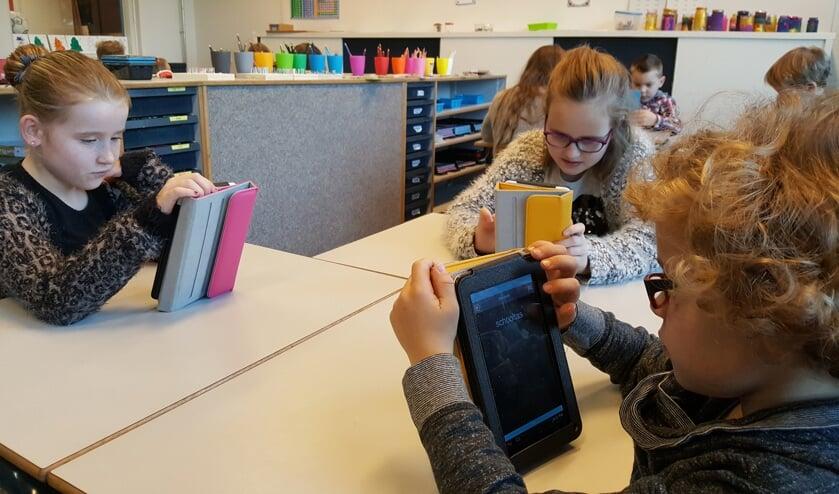 De leerlingen werken met Snappet op hun eigen niveau. Foto: PR