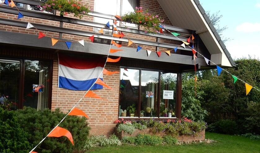 De woning van Annemieks moeder Ria versierd, na het wereldkampioenschap van Annemiek van Vleuten. Foto: Rinus Ilbrink