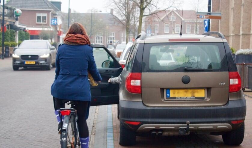 Langsrijdende fietsers hebben nu last van plotseling openslaande portieren. Foto: PR