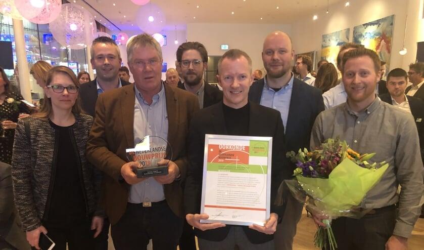 René Plaggenburg (met bruin jasje) te midden van een aantal projectteamleden. Eigen foto
