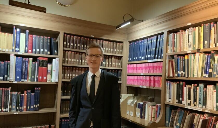 Guus na afloop van de verdediging van zijn dissertatie in de bibliotheek van het Merton College te Oxford. Foto: Jason Parisi