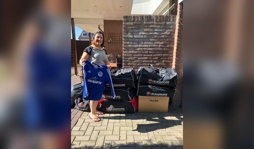 Dilsoz Wali is blij met de gedoneerde kleding. Foto: PR Grol