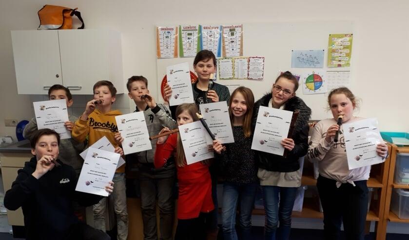 Blokfluiters van de Dorpsschool Halle behaalden hun diploma's. Foto: PR