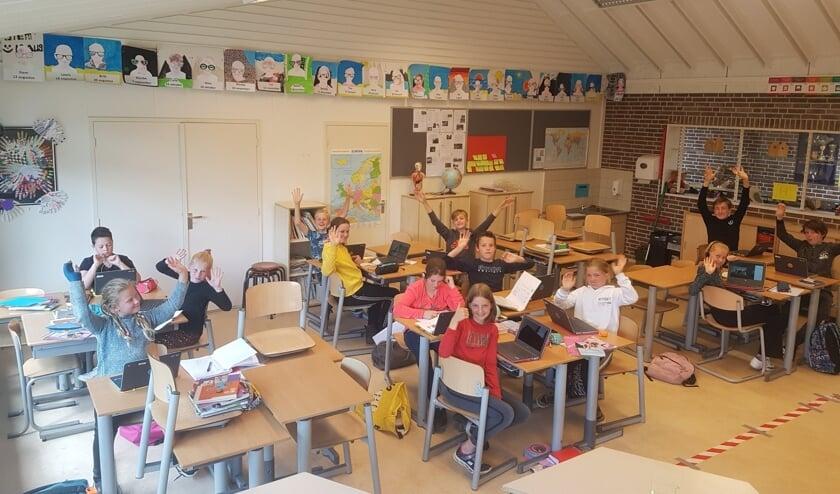De leerlingen zijn blij dat ze weer naar de Tormijnschool mogen. Foto: PR
