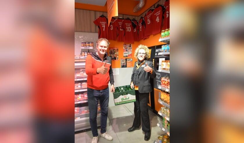 Rein Bruinsma, voorzitter Dash, en Monique van der Voort van Coop. Foto: PR