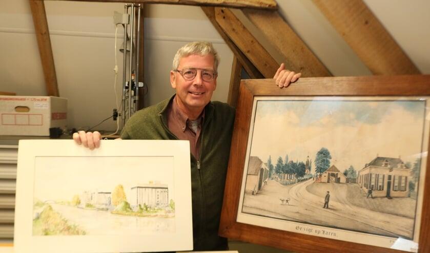 <p>Paul Roodbol met enkele van de vele tekeningen en schilderijen die het Historisch Genootschap bezit. Foto: Arjen Dieperink</p>