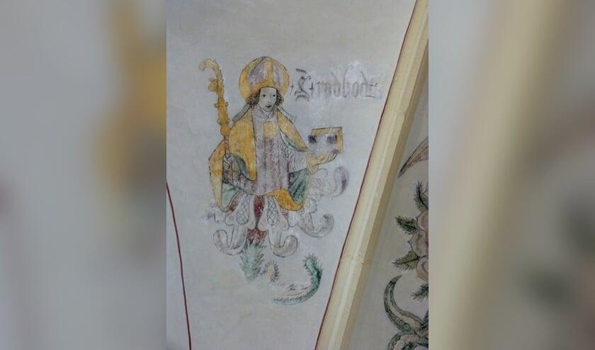 Bisschop Radboud, die in het Latijn over de zwaluw dichtte, op een muurschildering in de voormalige Broerenkerk in Zwolle, waarin nu boekhandel Waanders is gevestigd. Foto: Dries van den Akker s.j.