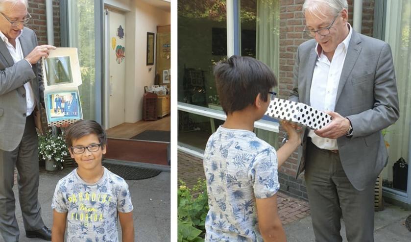 Jayden de Vies kwam Hans Romeyn feliciteren met een heuse taart.
