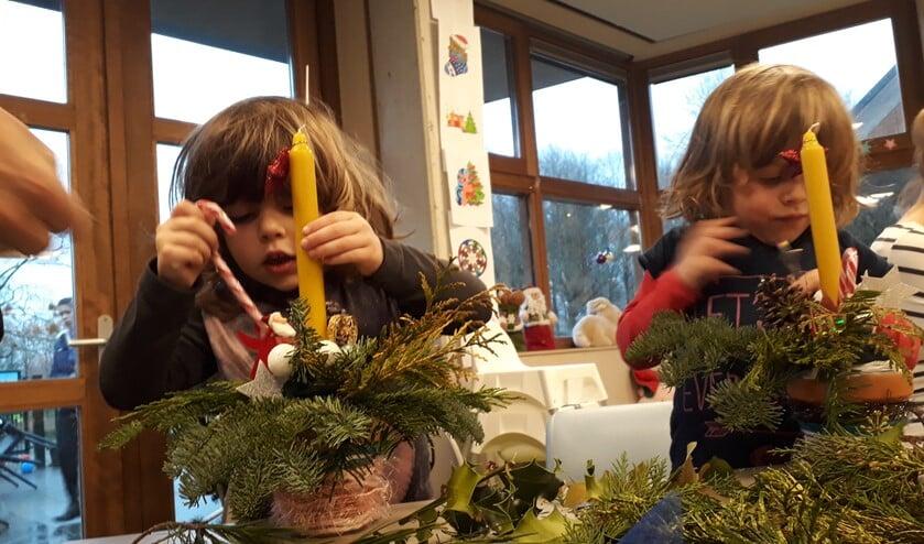 Er kunnen ook weer kerststukjes gemaakt worden.