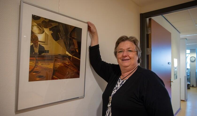 Carla koos zelf deze foto van een pianospeler die mooi reflecteert in de vleugel.