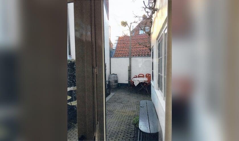 Het rode dak wordt, als het plan doorgaat, vervangen door een volledig glazen gevel met dezelfde hoogte.