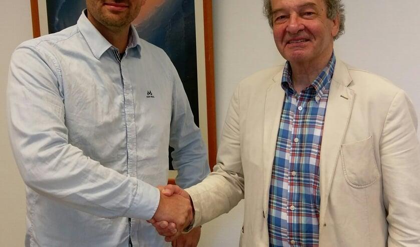 Geert Veldhuizen en wethouder Ebbe Rost van Tonningen.