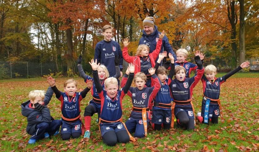 De U8 rugbyers zijn trots op de prestaties bij hun thuiswedstrijd