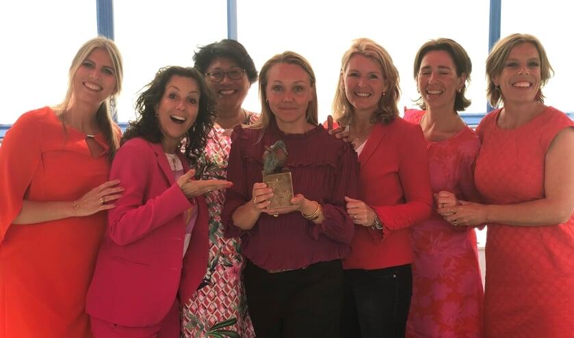 Het team coördinatoren die het werk organiseren van Met je hart uit De Bilt (met het appeltje).