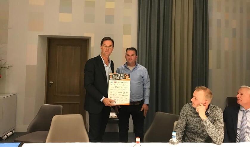 • Mark Rutte en Arnold Tuytel.