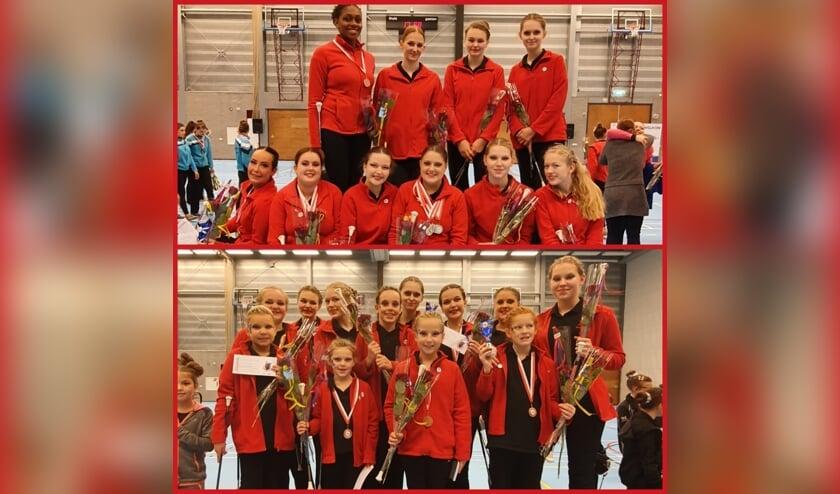 Alle dames van Doskonale Breda. Jainea is te zien op de onderste foto, achterste rij, vierde van links (met twee handen aan de roos).