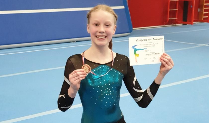 • Roos met haar bronzen medaille.