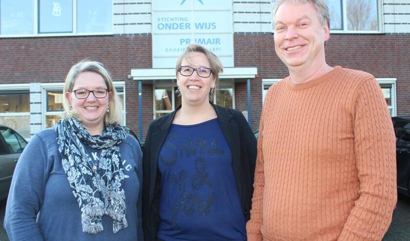 • Liesbeth Augustijn, geflankeerd door Janneke van Tol en Gerrit de Koster.