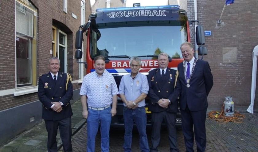 • De drie gedecoreerden met burgemeester Roel Cazemier.