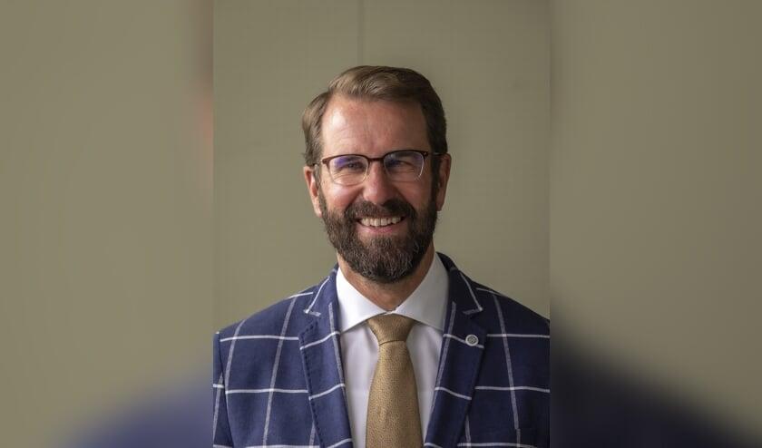 • Wethouder Hugo van der Wal van wonen.