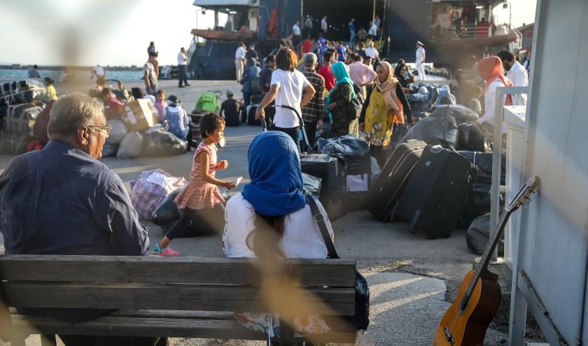 • Vluchtelingen in de haven van Thessaloniki, Griekenland.
