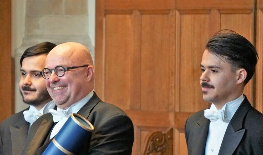 • De promotie in beeld, met v.l.n.r. Marc van 't Veer, Coen van 't Veer, Peter van 't Veer.