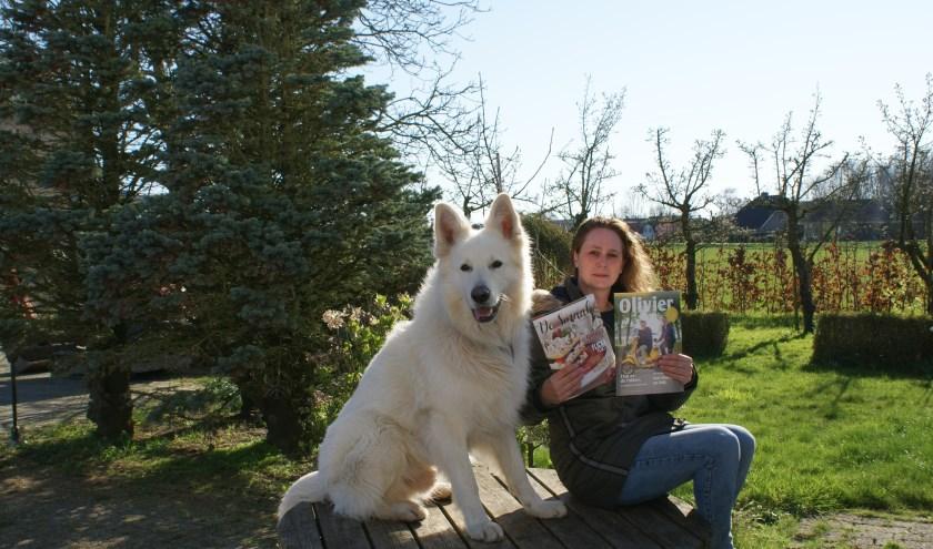 • Melanie van Hemert met haar hond Pim.