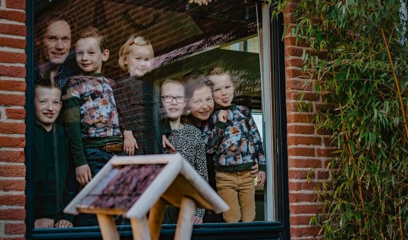 • Familie Burggraaf achter het glas.