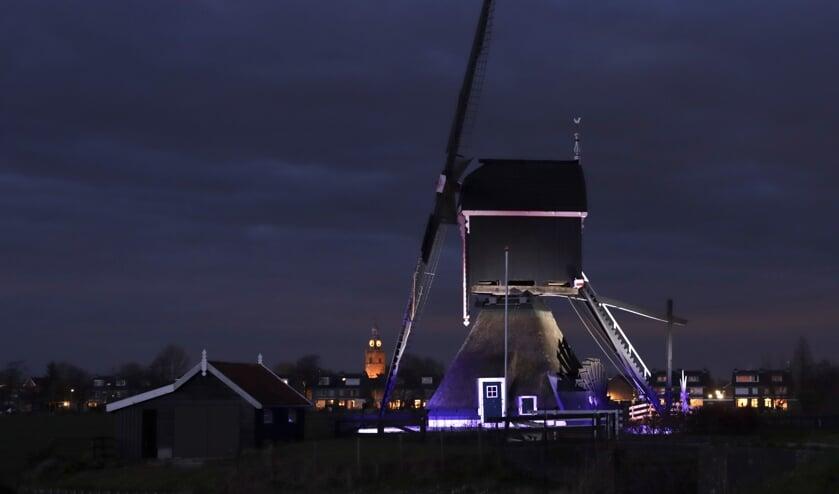 • De Tiendwegse molen in de verlichting.