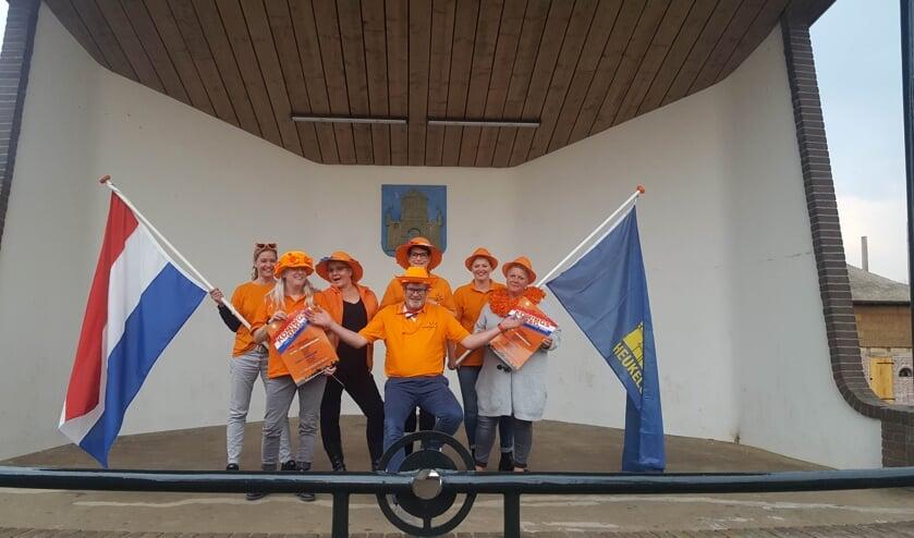 • Het bestuur van Oranjevereniging Heukelum geniet als anderen genieten.