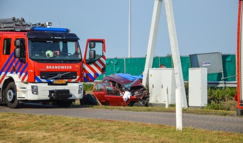 • De ernstig beschadigde auto.