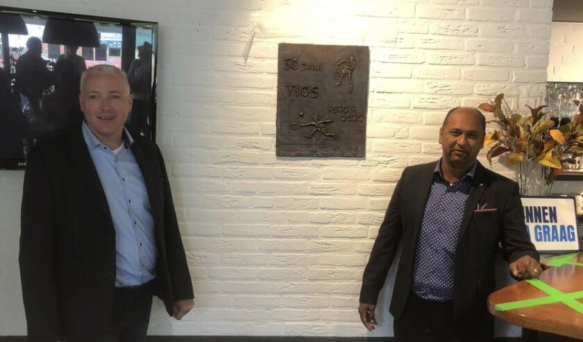 Voorzitter André Weima en wethouder Shah Sheikkariem.