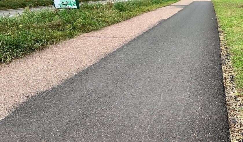 • Het bestaande rode asfalt van het fietspad langs de Steinhagenseweg is vervangen door zwart asfalt.