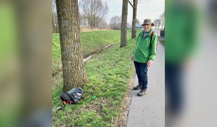 'De man met de prikker en de hoed, Joop van der Grijn uit Goudriaan.'