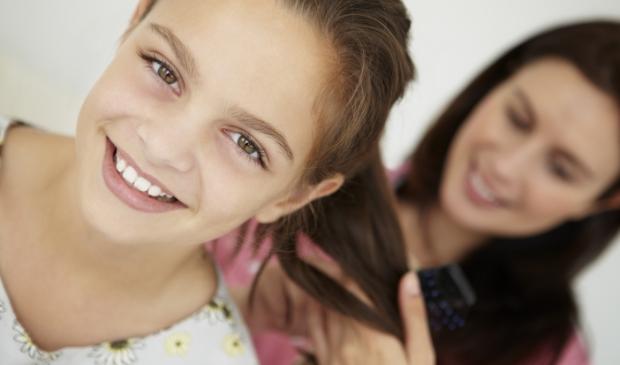11190579 - mother brushing daughter's hair