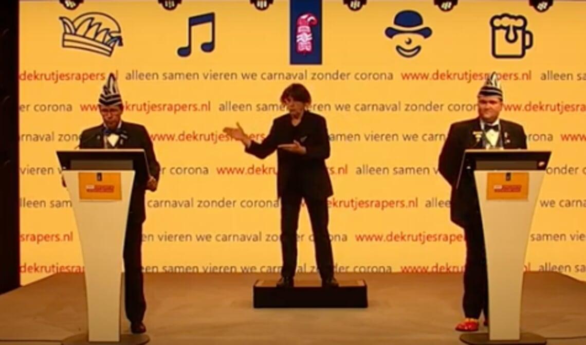 <p>Screenshot uit de 'persconferentie' met Jasper, Flip en de doventolk</p>