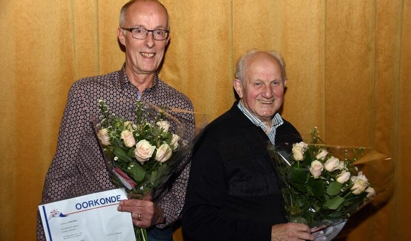 Piet Smits en Wim van Osch werden in de bloemetjes gezet.