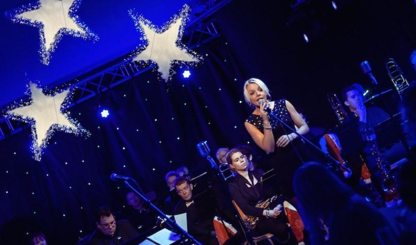 Kerstdinerconcert 2014 met een optreden van Iris Reivers.