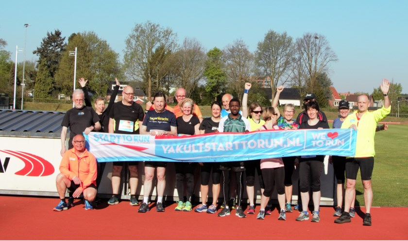 De deelnemers samen op de foto.