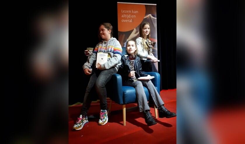 De drie winnaars van de regionale voorleeswedstrijd.