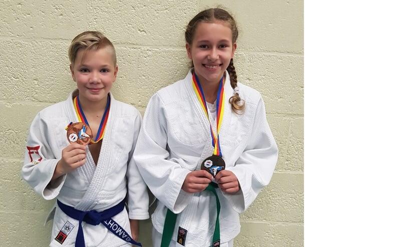 Thomas Vermeer met het brons en Xuxa Blom met haar gouden medaille.