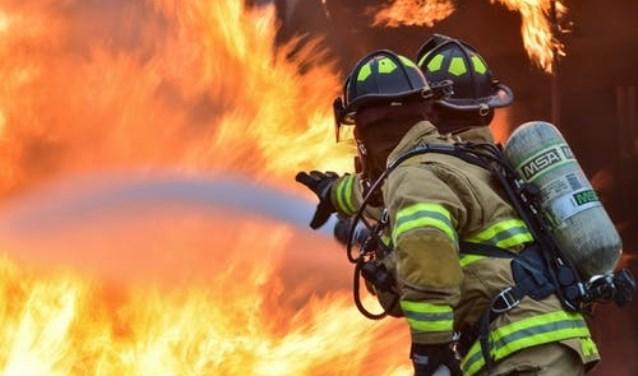 Negen Helderse brandweerlieden onderscheiden.