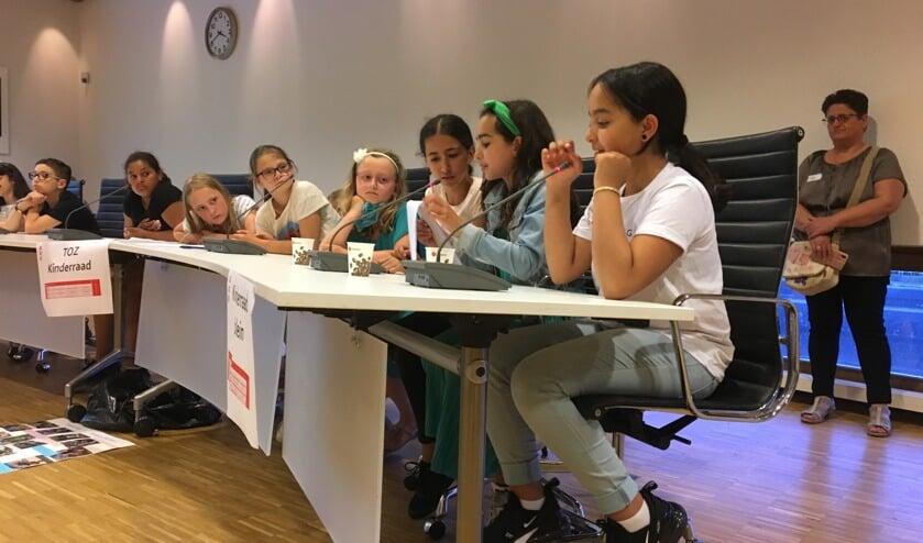 De kinderen namen de kinderconferentie serieus.