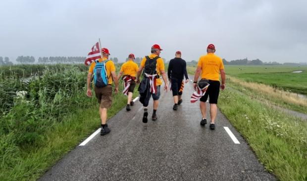 Vijf mannen tijdens 'De 50 van Alkmaar'.