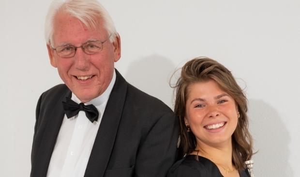 <p>Luc Mager (tubaïst, voormalig dirigent en 60 jaar lid van Amicitia) en Lisa Ruijsenberg (trompettist, begeleider jeugd en lid commissie 130 jaar Amicitia).</p>