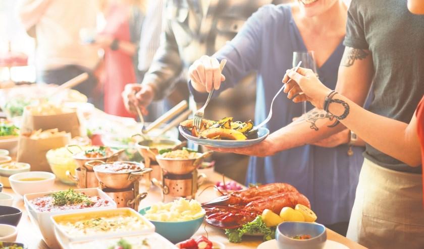 Foto: Wie komt er allemaal gezellig eten? FOTO SHUTTERSTOCK