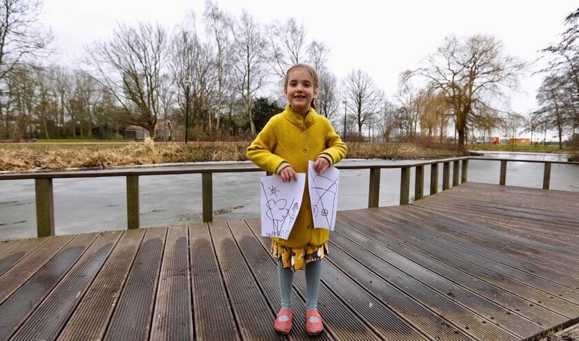 <p>Ook de 5-jarige dochter van Ilse Vergeer, Carina, zet een vink door groen en een kruis door woningen in Pasgeld. &quot;Zo snappen ze het misschien wel bij de gemeente.&quot;&nbsp; (Foto: Koos Bommel&eacute;)</p>