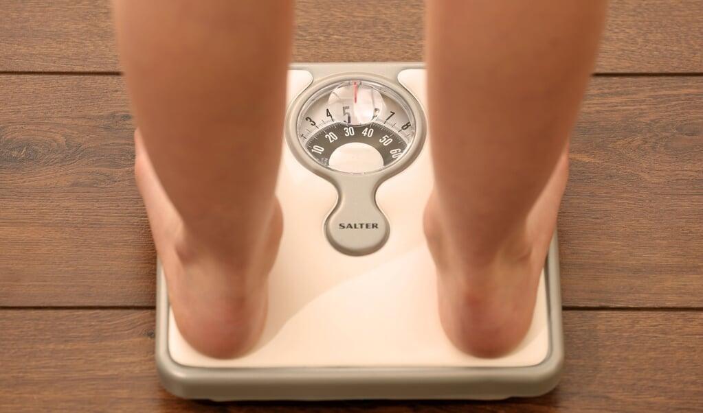 Ofte viser vægten for mange kiloer i forhold til børnenes højde.  ( dpa)