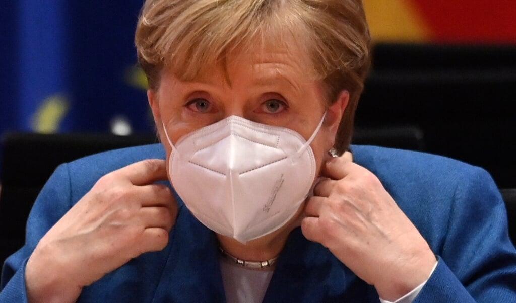 Kansler Angela Merkel (CDU)  har ifølge kilder advaret om, at smittetallene kan blive tidoblet inden påske.    (John Macdougall/POOL afp/dp)