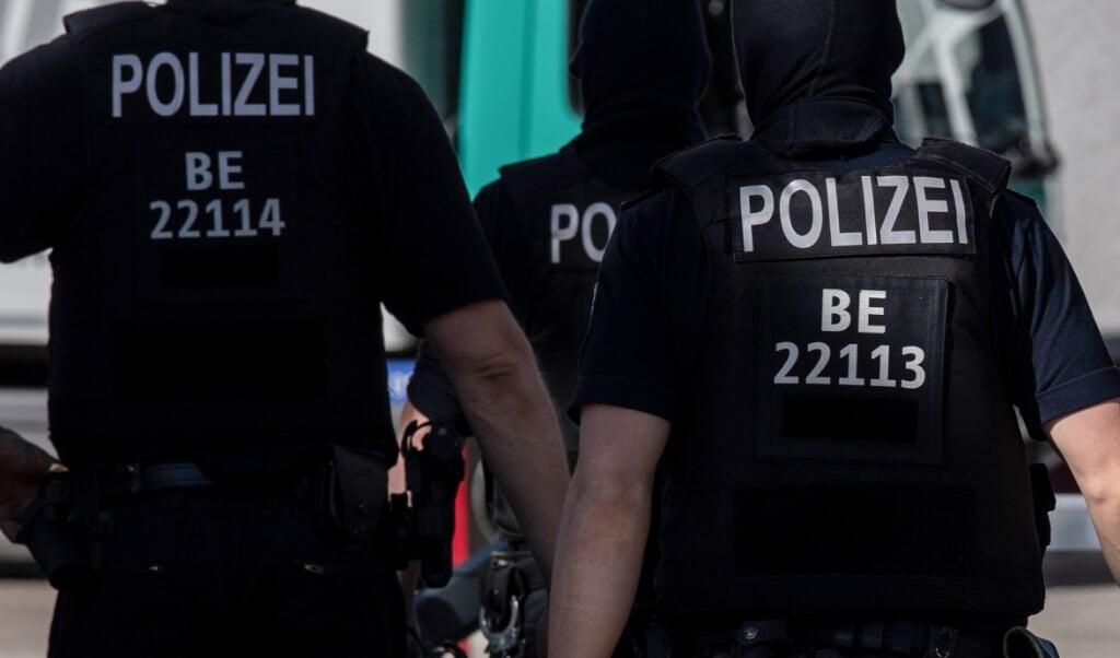 Politiet pågreb manden, mens han sad foran en tændt computer. Genrefoto:   (Paul Zinken/dpa )